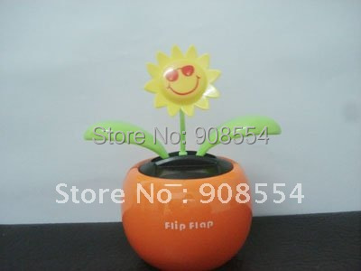 Hot selling flip flap solar flower orange +smail face 15pcs per lot Free shipping via China post air parcel(China (Mainland))