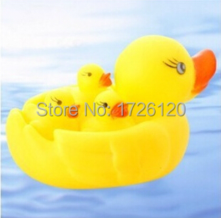 4 pcs 1 Set Cute Baby Bath Toys Rubber Race Squeaky Duck Big Yellow Duck Mother 3 pcs Duck Baby Classic Toys Free Ship(China (Mainland))