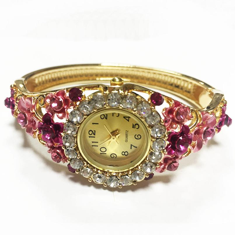 Excellent Quality 2016 New Design Women Wrist Watches with Red Crystal Flower Bracelet Quartz Watch <br><br>Aliexpress