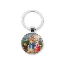 SONGDA Vintage Peter Rabbit Tema Keychain Helen Beatrix Potter Coelho Divertimento Dos Desenhos Animados Impresso Cúpula De Vidro Anel Chave Do Presente para a Menina crianças(China)
