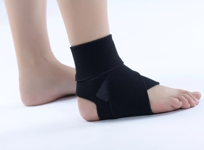 sprained ankle bandage A sprained ankle refers to damage to the ankle ligaments and other soft tissues around the ankle the ligament damage causes bleeding within the tissues and an extremely painful swollen ankle.