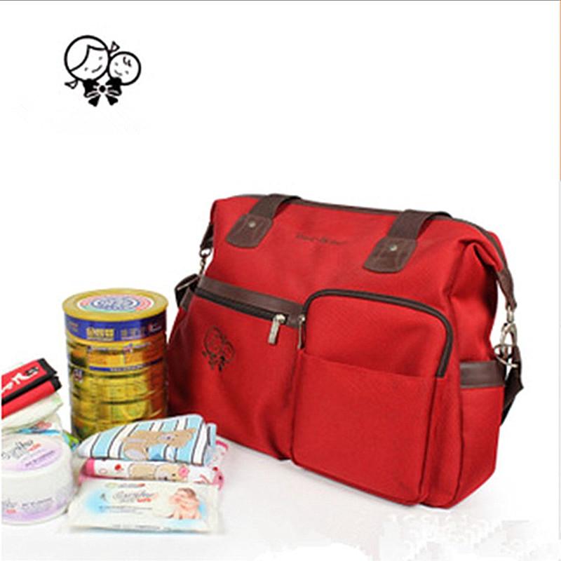 of Multi Pocket mom bag mummy bag bulk mummy bag shoulder bag factory straight hair spot across the pregnant women