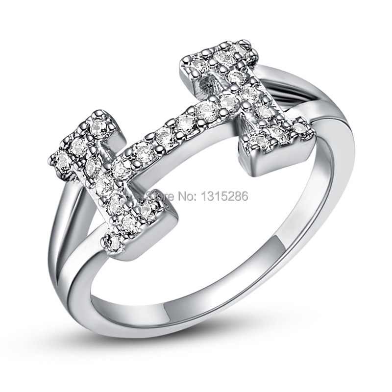 noble h logo letter gem ring luxury shine