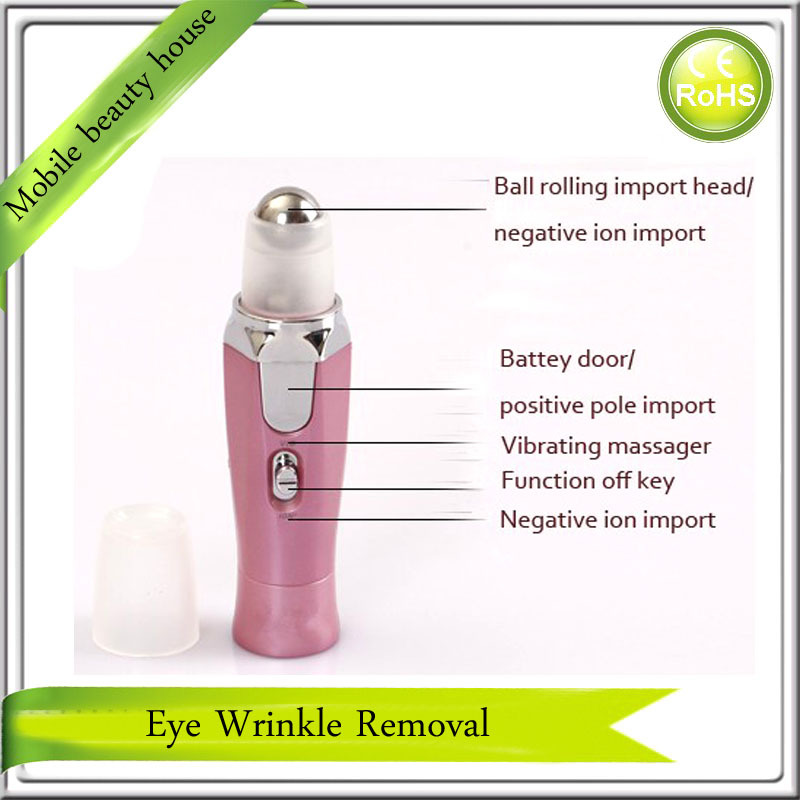 Battery Operated Mini Handheld Eye Beauty Care Anti Wrinkle Vibration Massager Roller Free Shipping(China (Mainland))