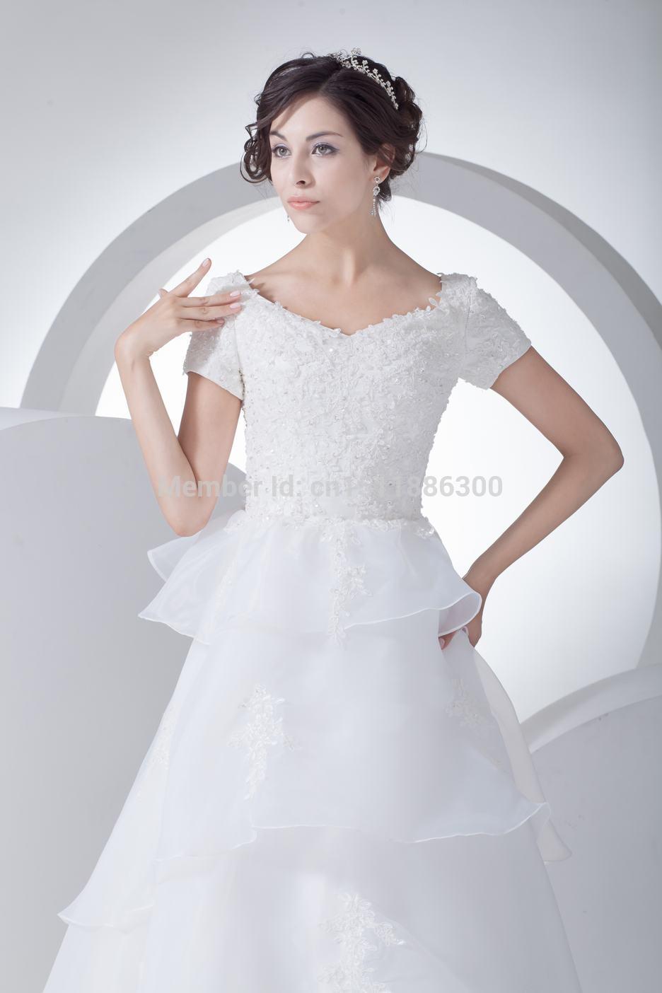 Vestidos de boda de la manga del casquillo del cordón