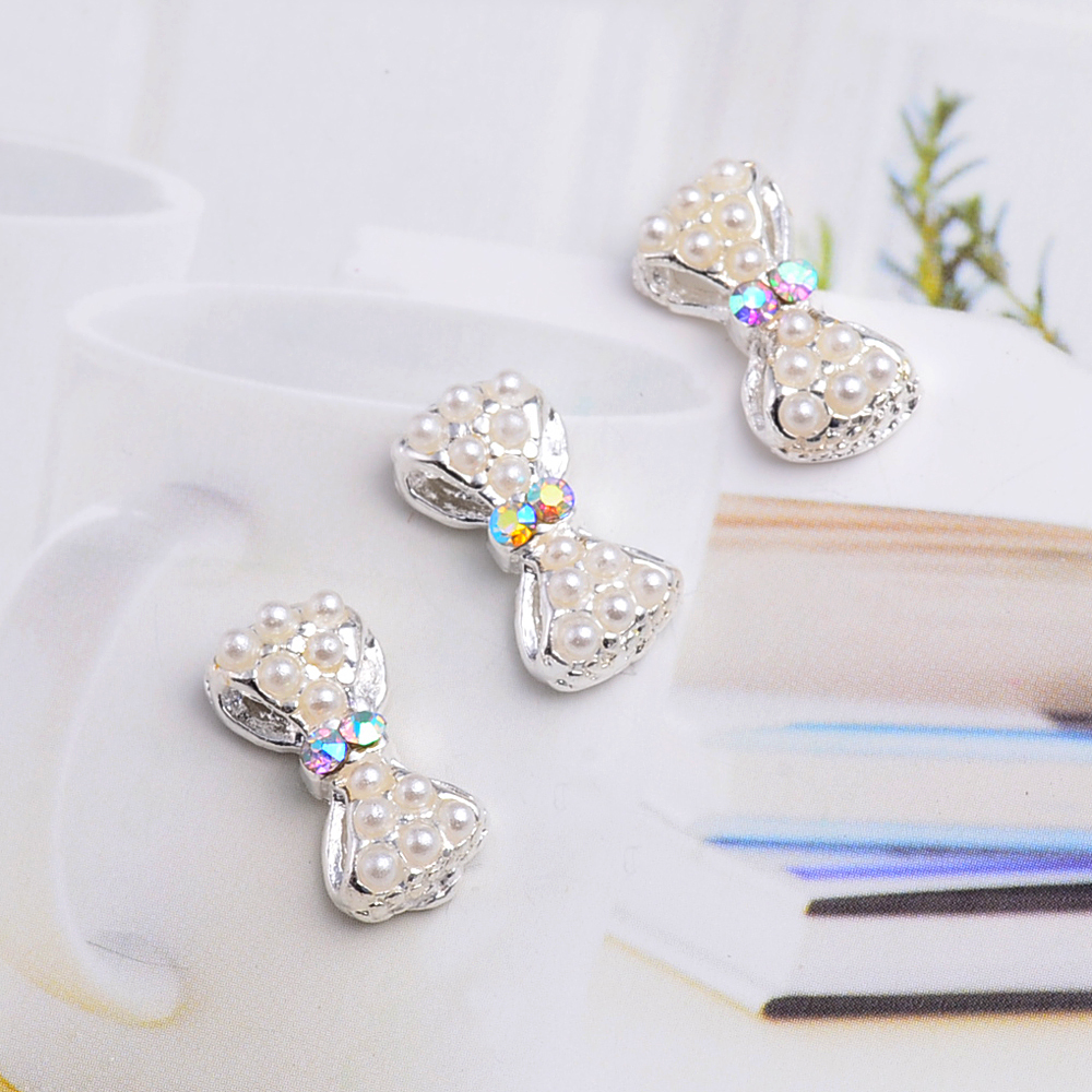 10Pcs New 2015 Pearl Nail Bow,3D Metal Alloy Nail Art Decoration/Charms/Studs,Nails Rhinestones 3d Nail Supplies TN076(China (Mainland))