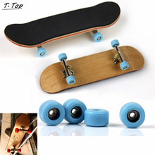 Professional PU Skid Pad Wood Alloy Stent Bearing Wheel Mini Finger Skateboard Fingerboard Toy for Kids Children(China (Mainland))