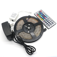Buy RGB Led Strip IP65 Waterproof 5M SMD 3528 300 LEDs/Roll Led Strip Light +44 keys IR Remote + DC12V Power Adapter for $7.39 in AliExpress store