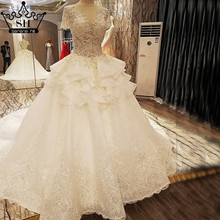 Luxury High-end White Lace Sexy Wedding Dress Short Sleeves Sequined Pearls Brush Train Bridal Gowns 2017 Vestido De Noiva(China (Mainland))