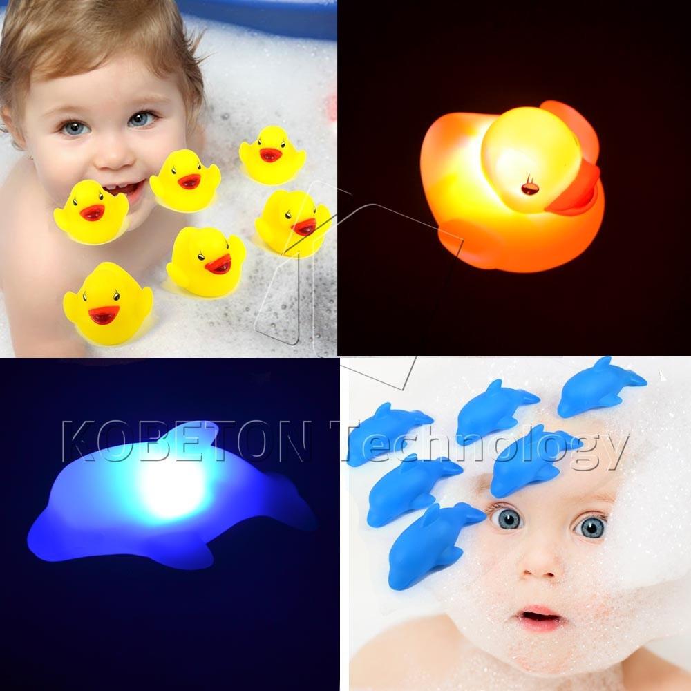 Yellow Duck Blue Dolphin Flashing Light Baby Kits Bath Toy Baby Bathroom Flash Lighting Toys Led Change Multi Colors(China (Mainland))