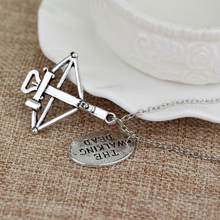 "The Walking Dead Crossbow Necklace with ""FEAR THE LIVING"" Charm"