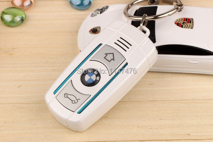 Free shipping best quality Retail LOGO x6 flip phones Mini Car Key Cell Phone Kids Student Cute Special Cell Phone(China (Mainland))