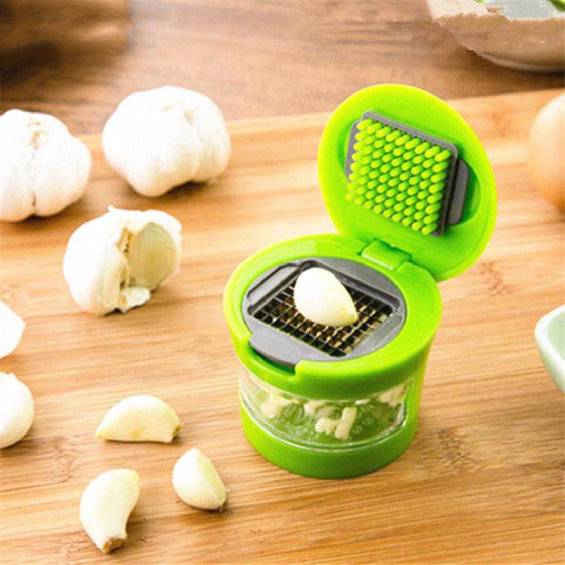 Practical Garlic Chopper Plastic Stainless Steel Garlic Press Multi Functional Ginger Mashing Machine Kitchen Tools(China (Mainland))