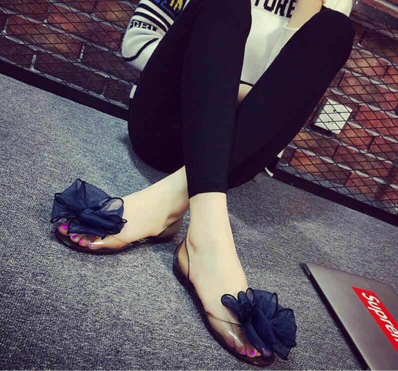 New summer jelly transparent women lovely sandals candy crystal plastic open toe flat shoes female flower beach slipper(China (Mainland))