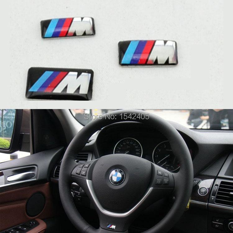 20pcs/lot, New Car styling M small Decorative Badge Hub caps Steering wheel Car Emblem Sticker 17.4 X 9.4 mm(China (Mainland))