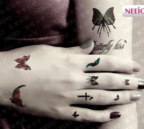 Pics for cross tattoos for girls on finger for Back of wrist tattoo
