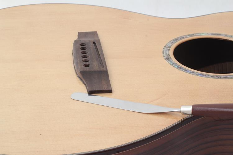 Guitar repair tools, saddle glue from the repair tools, saddle separator