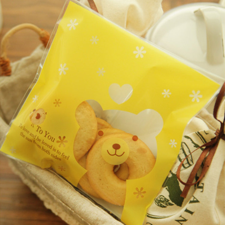 2015 Top Fashion 100pcs Yellow Bear Food Bag Moisture Proof Plastic Cookie Cake Snacks Candy Package Christmas Packaging Bags(China (Mainland))