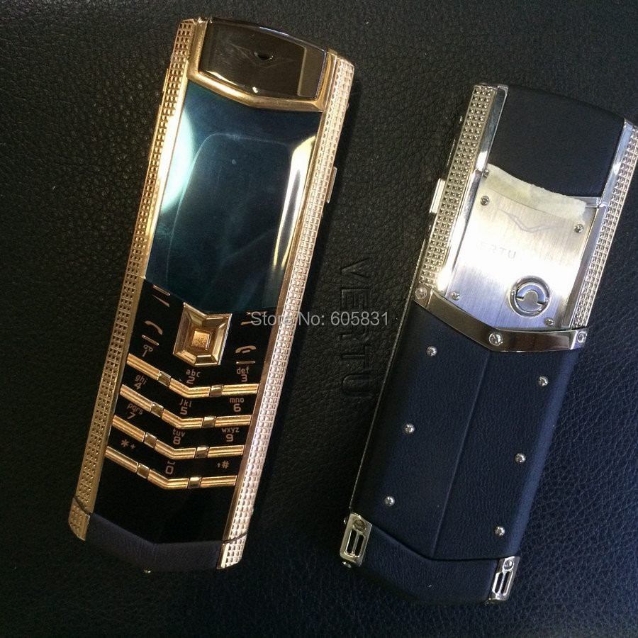 Free Shipping Best price Unlocked Signature phone Paris nail Clous Red Gold luxury mobile phone steel Real Leather cell phone(China (Mainland))