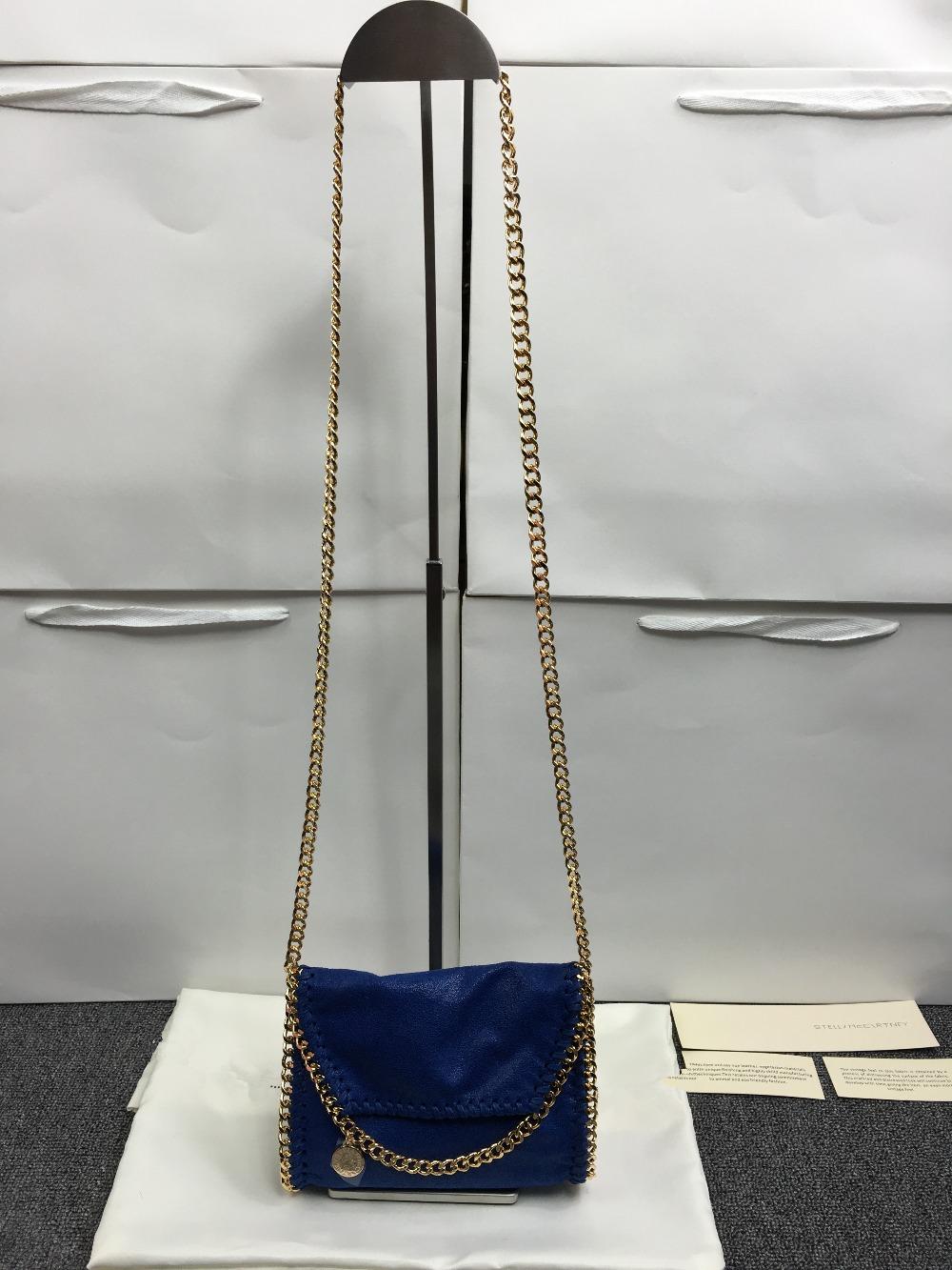 Фотография mini LADY personal bag S*T Shoulder Messenger chain GOLD CHAIN handbag original material PVC star package