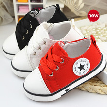 Classic child canvas shoes soft bottom girls and boys shoes lace Korean version of the solid color 2015 new wholesale(China (Mainland))