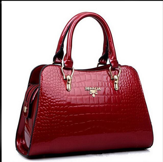 2015 New Genuine Patent leather Handbags Tote Fashion Ladies Shoulder Messenger Bags Hollow out Women Bag bolsa femininas(China (Mainland))
