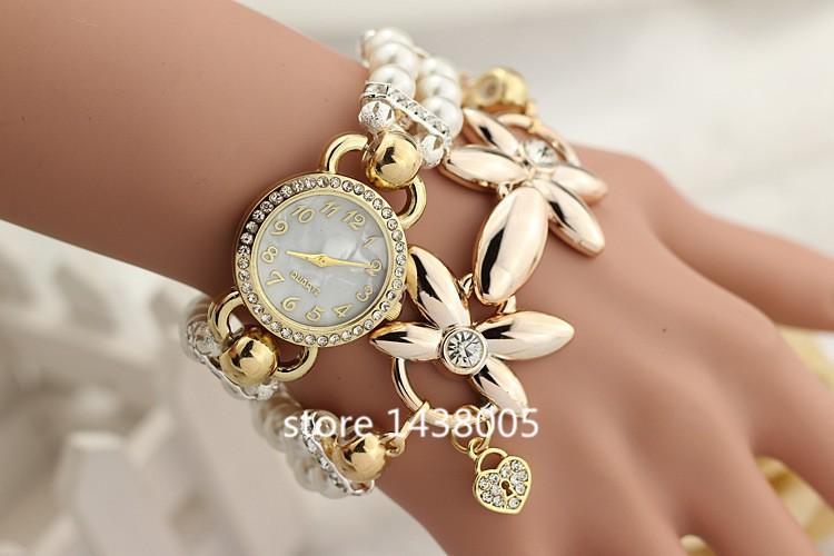 Часы женские кварцевые с белым жемчужным браслетом фото