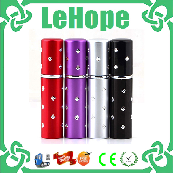 Free shipping 4pcs Amazing Travel Perfume Atomizer Refillable Mini Perfume Bottle ,Red,Purple,,Silver,Black(China (Mainland))