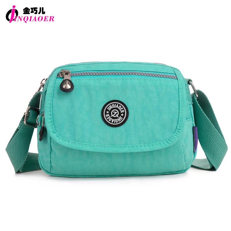 JINQIAOER Stylish Small Nylon Messenger Bag Women Waterproof Nylon Crossbody Bags Double Layer Satchels O Bag For Iphone Bolsa(China (Mainland))