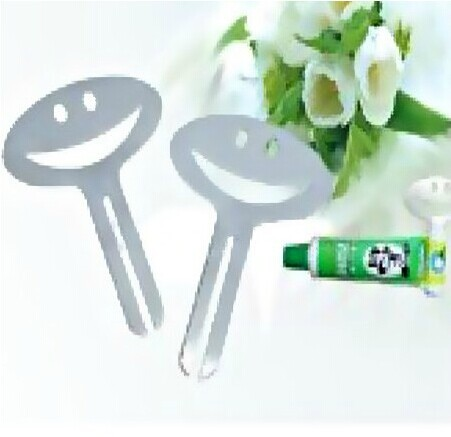 2pc smile Cartoon Cute Shape Toothpaste Dispenser Easy Squeeze Tube Toothpaste Squeezer New(China (Mainland))