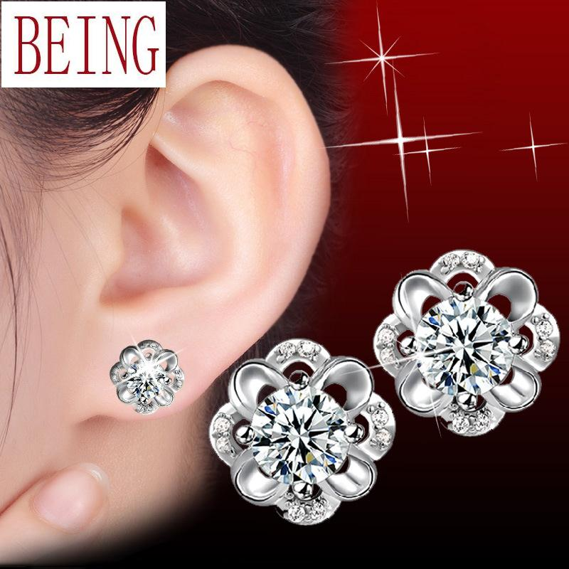 Hot new fashion high quality silver earrings charm zircon crystal hollow plum flower design jewelry wholesale(China (Mainland))