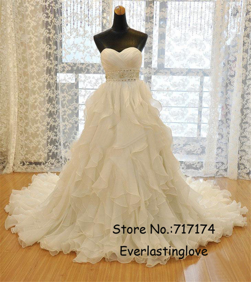 Sweetheart chapel train ball gown wedding dress with for Tiered ruffle wedding dress