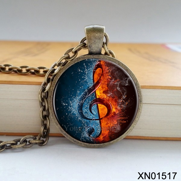 Free shipping fashion musical notes necklace music is one half water and one half fire Zinc alloy Glass pendant retro necklace(China (Mainland))