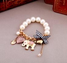 Free shipping! Retro jungle Wind,peach heart,bow,cute Elephant bracelet,Pearl Stretch chain Bangle. Nice gift jewelry(China (Mainland))