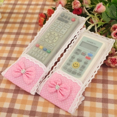 Bow fabric remote control to set the TV / air conditioning, remote BOOT anti-stain mesh protective sleeve(China (Mainland))