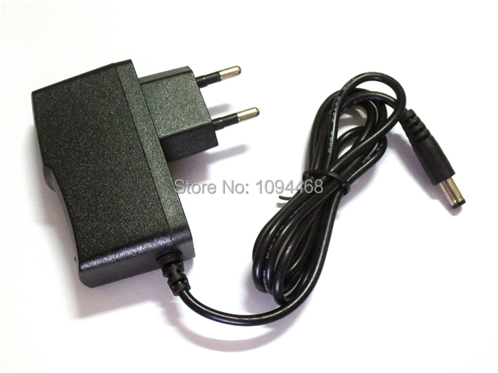 Free Shipping AC 100V-240V to DC 6V 1A Power Supply Adapter charger 5.5mm x 2.1mm 1000mA EU(China (Mainland))