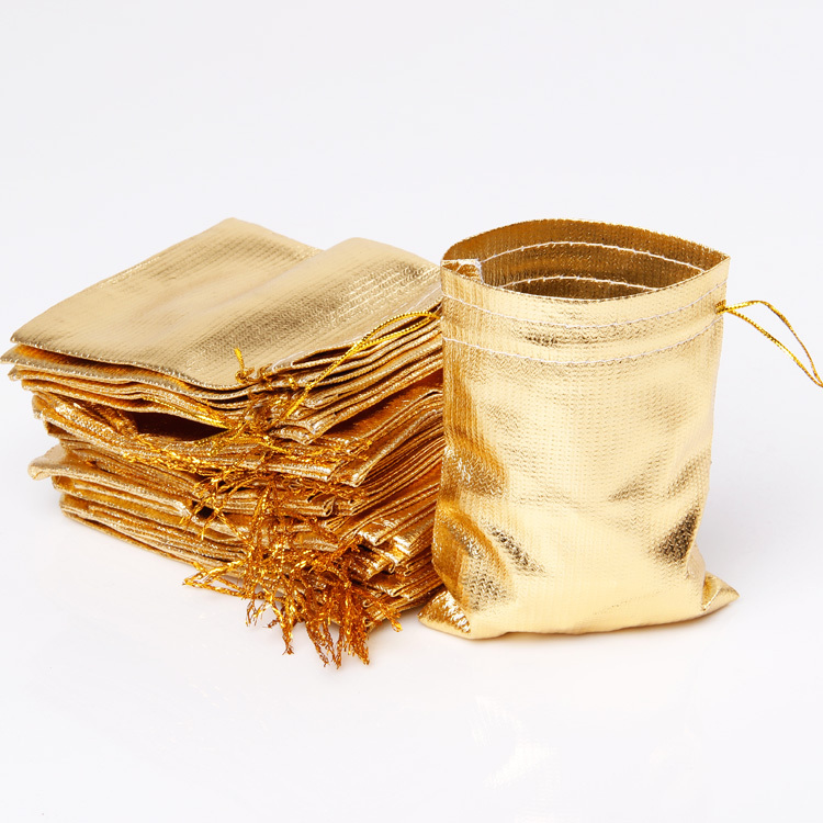 100pcs wholesale leather gold jewelry pouch bag for gift on wedding christmas beauty design 7*9(China (Mainland))