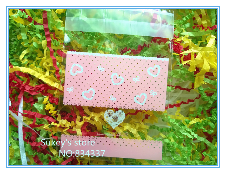 200pcs/lot pink heart plastic packaging bags,7x7cm samll cookie bags food packing bag free shipping(China (Mainland))