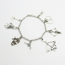 The Walking Dead inspired bracelet Daryl's arrow motorcycle cowboy hat Gun Lantern Hammer charm bracelet(China (Mainland))