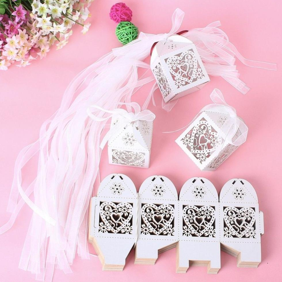Free shipping 50pcs Laser Cut love heart Wedding Favor Box in Pearlescent Paper with Ribbon Wedding Party Creative Favor Bags(China (Mainland))