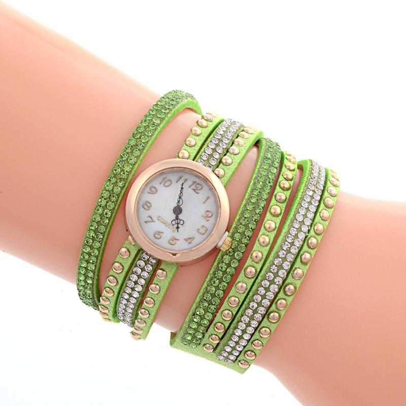 Часы женские с зеленым ремешком. фото