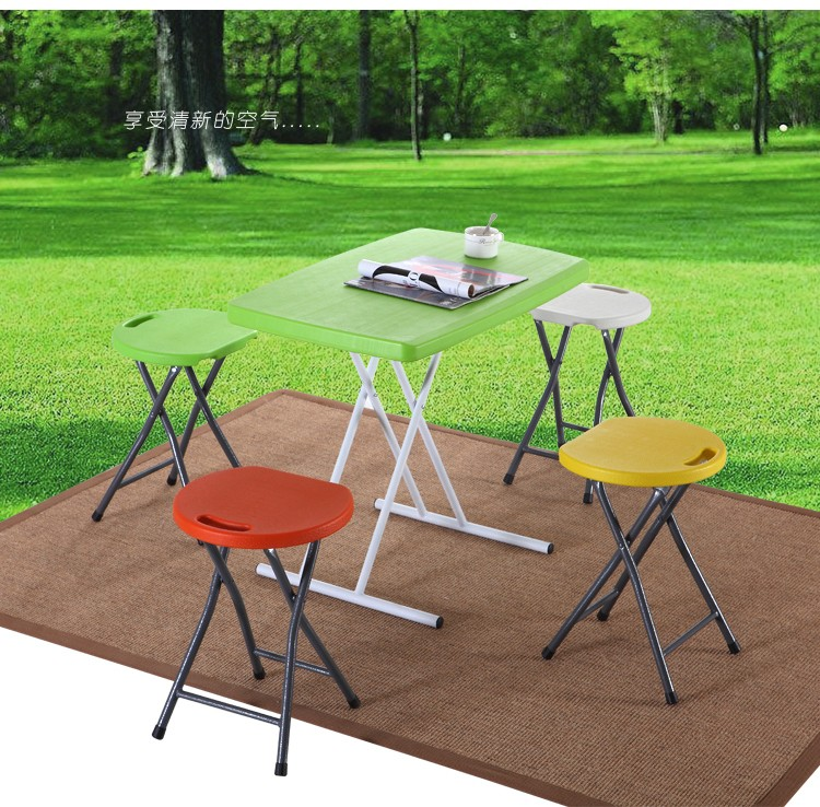 Foldable computer desk. Home portable dinner. Simple table of outdoor stalls picnic table.