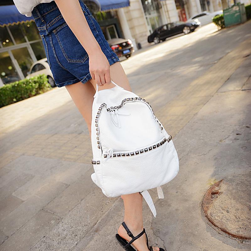 wash leather pu soft backpack The new 2015 rivet fresh street bag Girl's beautiful Recreation bag Women's white black bag(China (Mainland))