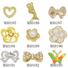 10Pcs/lot Gold Hollow Bowknot Flower 3D Nail Art Rhinestone Decorated Butterfly Nail Sticker Charm Glitters DIY Tool Supplies(China (Mainland))
