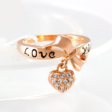 Gold ring with heart charm