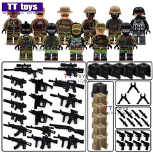 11pcs SWAT Team police officer tactical unit Minifigures Military Figures with weapon DIY Assemble Children Gift CollectionToys(China (Mainland))