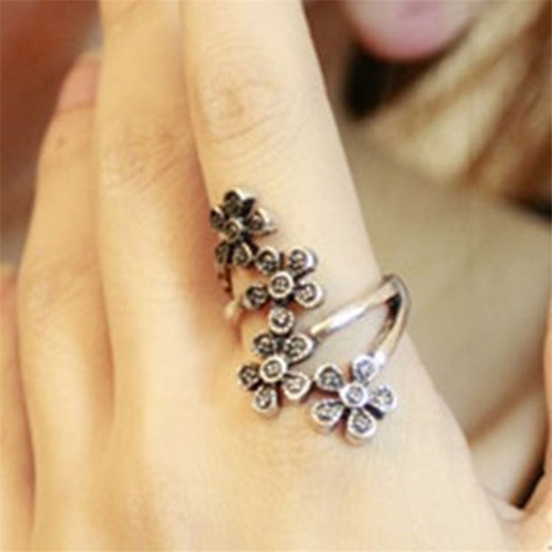 Summer real Beautiful girl rings Korean jewelry Four small plum style flower vintage ring Cheap Wholesale free shipping 2015(China (Mainland))