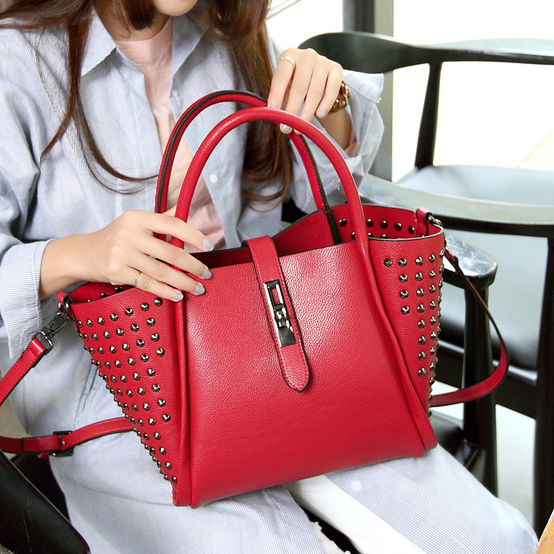 New Arrival Genuine Leather Ladies Hand Bags Fashion Rivets Handbag Good Quality Trapeze Leather Bag Tote Feminina Shoulder Bag(China (Mainland))