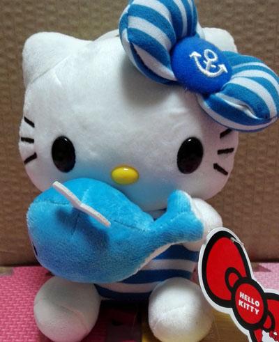 New arrival 18cm kawaii hello kitty toys soft stuffed plush toy Hello kitty toy lovely kitty doll Kitty holding dolphin dolls(China (Mainland))