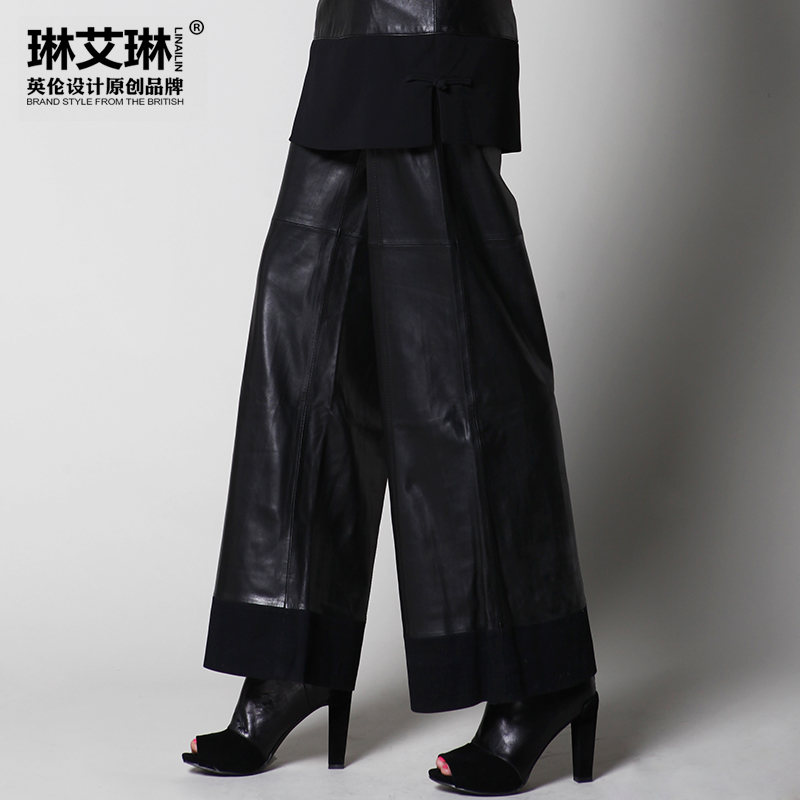 Black Kenzo leather wide-leg pants with tonal stitching throughout, perforated floral designs at side pant-legs and hidden side zip closure.